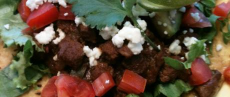 Tostada Compuesta with Carne Guisada (Tostada with Braised Beef)